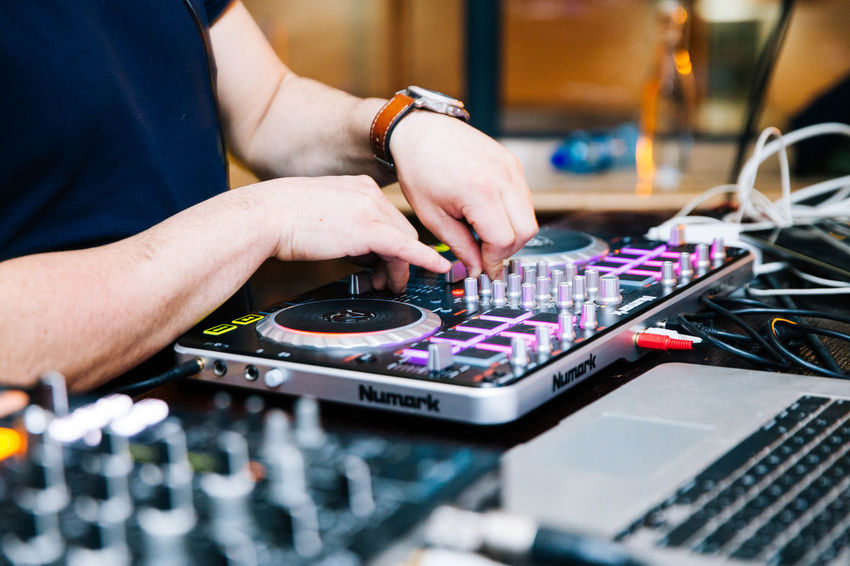 Arts Culture And Entertainment Audio Equipment Body Part Club Dj Control Electrical Equipment Finger Hand Human Body Part Human Hand Human Limb Indoors  Men Mixing Music Nightlife Occupation One Person Real People Selective Focus Skill  Sound Mixer Sound Recording Equipment Technology Working