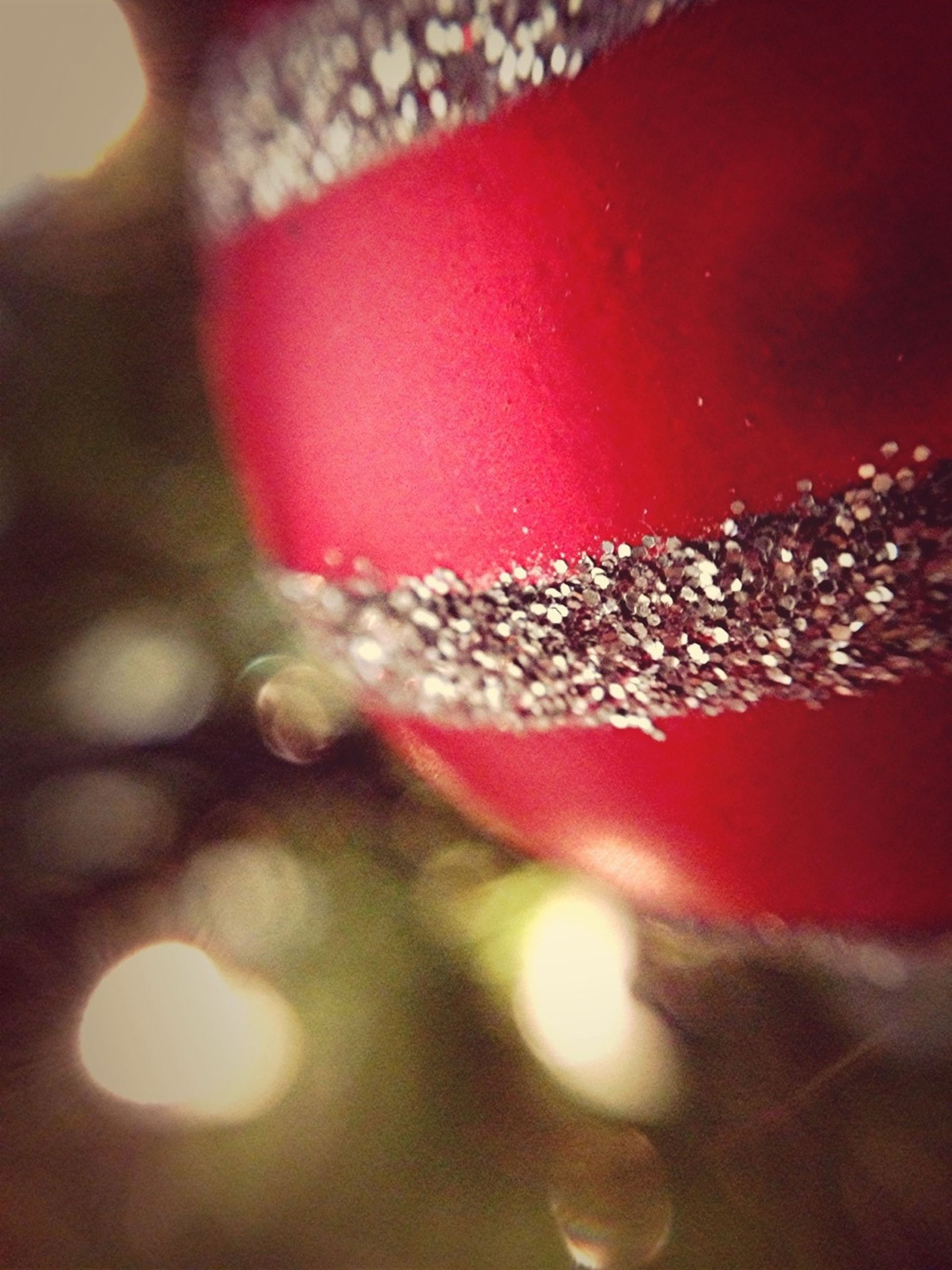red, close-up, indoors, focus on foreground, selective focus, no people, glass - material, decoration, freshness, transparent, christmas, still life, celebration, pink color, illuminated, detail, defocused, fragility, christmas decoration, reflection