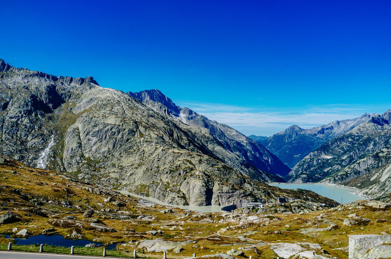 Idyllic shot of mountains against blue sky