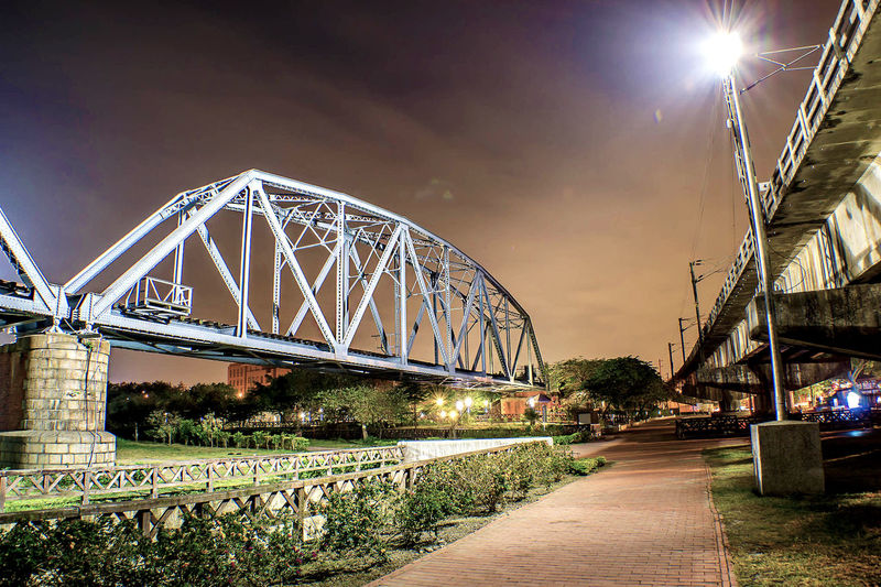 Low angle view of railway bridge at dust
