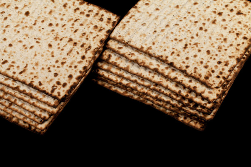 Traditional Jewish matzah on a black background. Close-up Passover Black Black Background Bread Breakfast Brown Brown Bread Close-up Food Food And Drink Freshness Healthy Eating High Angle View Indoors  Kosher Matza Matzah Matzo Matzoth No People Pesach Ready-to-eat Religion Single Object SLICE Snack Still Life Studio Shot Toasted Bread Two Objects Wellbeing