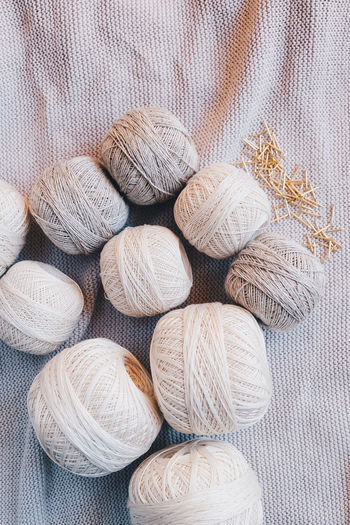 Textile Still Life No People Close-up Backgrounds Indoors  High Angle View Pattern Large Group Of Objects Variation Choice Wool Art And Craft Textured  Thread Material Group Of Objects Full Frame Softness Neutral Colors Yarn Yarn Balls Cotton Cotton Balls Strings