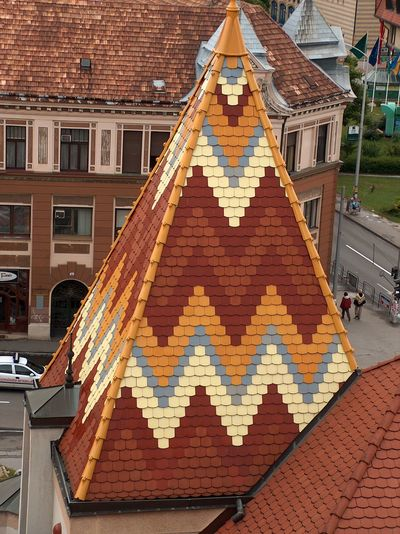Architecture Brick Wall Building Building Exterior Built Structure City Cobblestone Culture Day Exterior Geometry House Low Angle View Outdoors Pattern Religion Repetition Residential Structure Roof Spirituality Symmetry