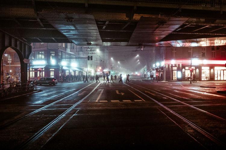 People in illuminated city at night