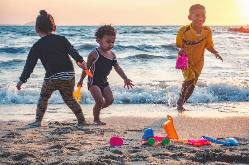Boys playing on beach