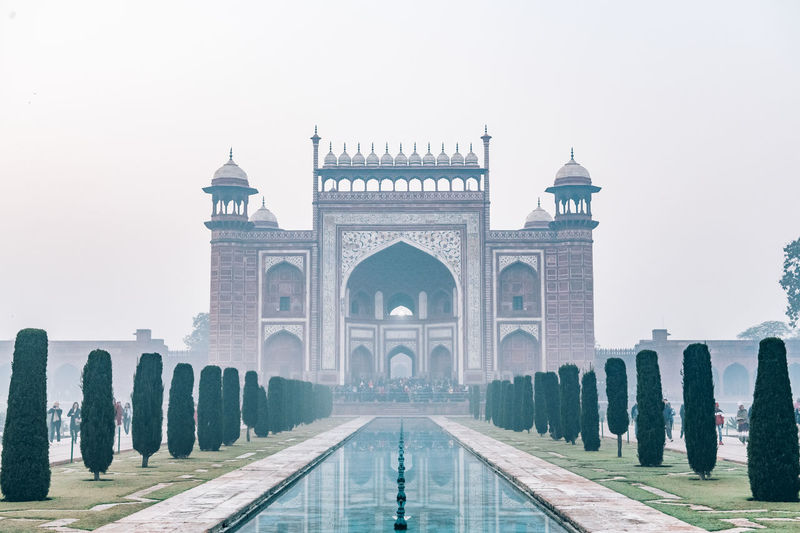 Taj mahal gate at foggy sunrise in winter