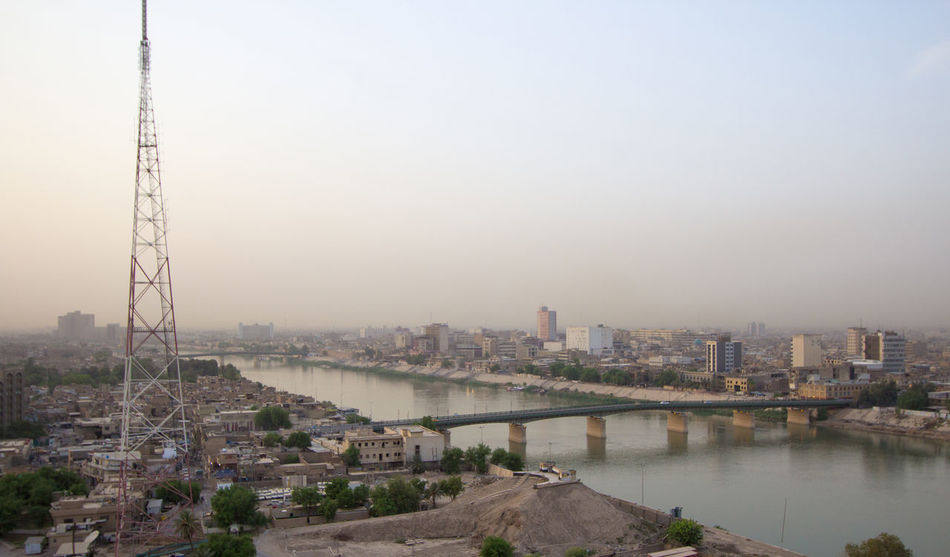 Aerial photo of the city of Baghdad, and shows where residential complexes and the Tigris River and bridges. The city of Baghdad, capital of Iraq. Tigris River Baghad Baghdad Baghdad , Lraq By The River City City Life City Lights City Skyline City View  Cityscapes Discover Your City Iraq Iraq . Baghdad Iraq_photo Iraqi  My City River River Collection River View Riverscape Riverside Riverview Tigris Tigris Bavaricus Tigris River Tigris Y Éufrates