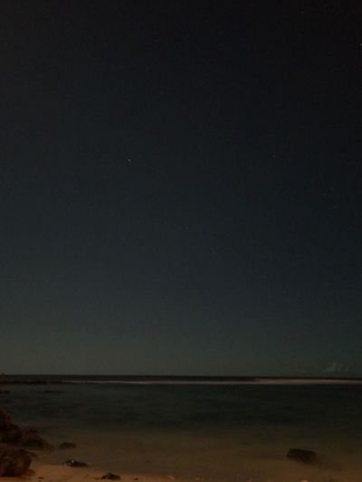 Nature Tranquil Scene Scenics Beauty In Nature Sea Tranquility Horizon Over Water Night Beach Sky No People Sand Water Outdoors Astronomy Moon Lights Up The Night Longexposurephotography Lowlightphotography in Maili, Oahu United States