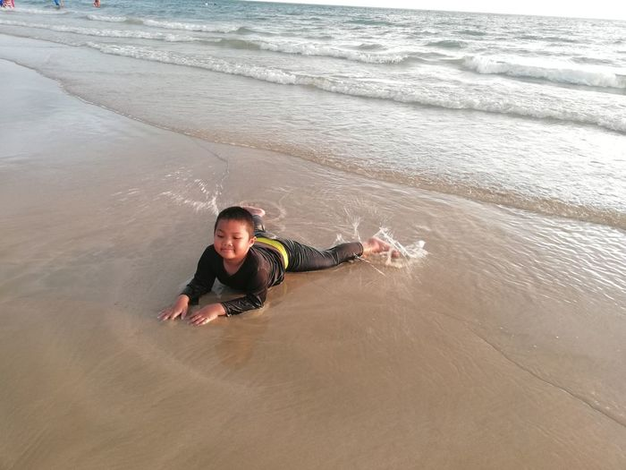 Children enjoy on summer trip 2019,หาดเจ้าหลาว Achi2019 Boy Sea Water Beach Leisure Activity Land One Person Lifestyles Portrait Real People Looking At Camera High Angle View Men Sand Casual Clothing Nature Weekend Activities Wave Beauty In Nature Outdoors