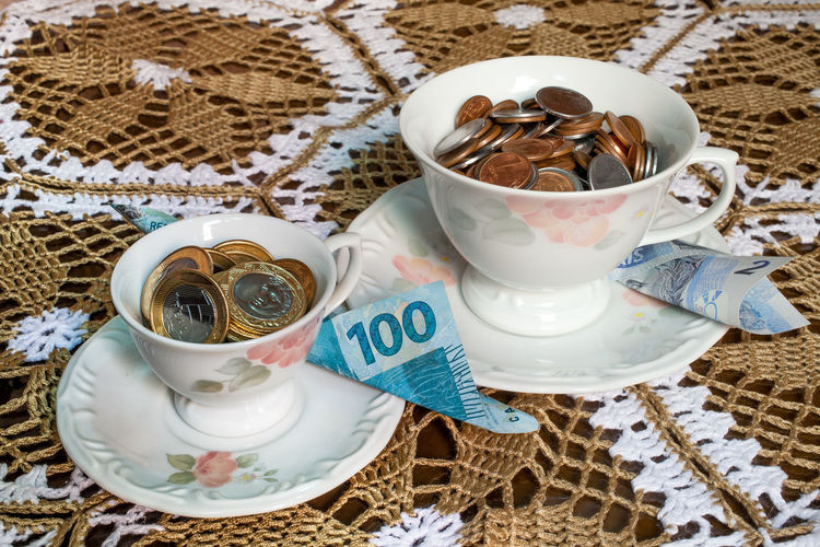 Cup Food And Drink Drink Mug Coffee Cup High Angle View Coffee Still Life Kitchen Utensil Eating Utensil Tea Close-up Tea Cup Temptation Money Economy Finance Conceptual Concept Food Alimentation Ecology Capitalism Capitalist Corruption