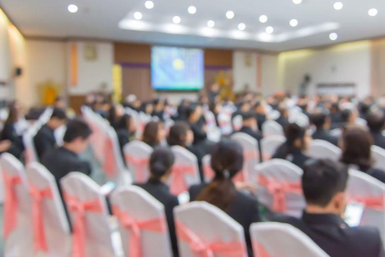 Defocused image of business people at seminar