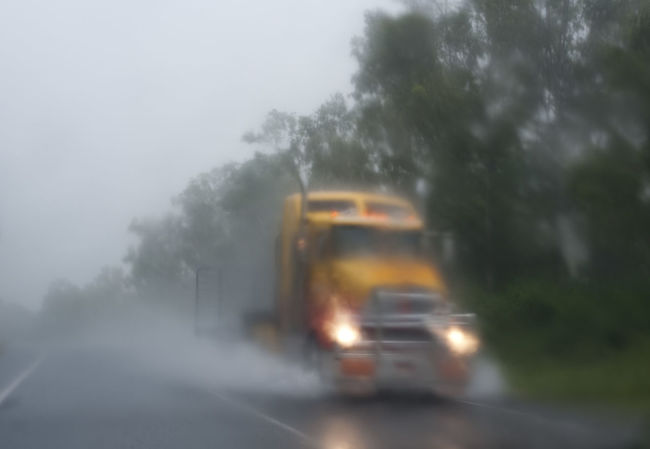 abstract water blur - a truck travelling at speed on a wet day Big Rig Blur Dangerous Glow Headlights Lights Mist Orange Rain Reduce Speed Truck Yellow