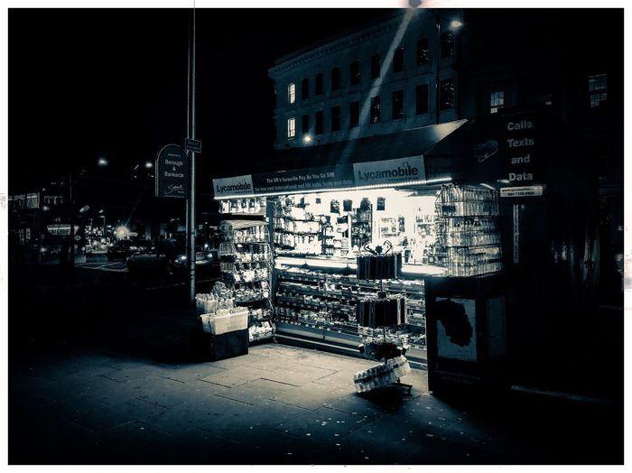 Bright @ night Bubblegum Urban Streetphotography Street Mobilephotography IPhoneography ShotOnIphone IPhone Only IPhone X IPhone Blackandwhite Bnw Postcode Postcards LONDON❤ London London Bridge Newsstand Light Night Building Exterior Architecture Built Structure No People Outdoors Illuminated City