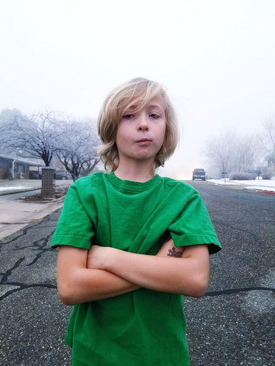 Boy on snow covered landscape