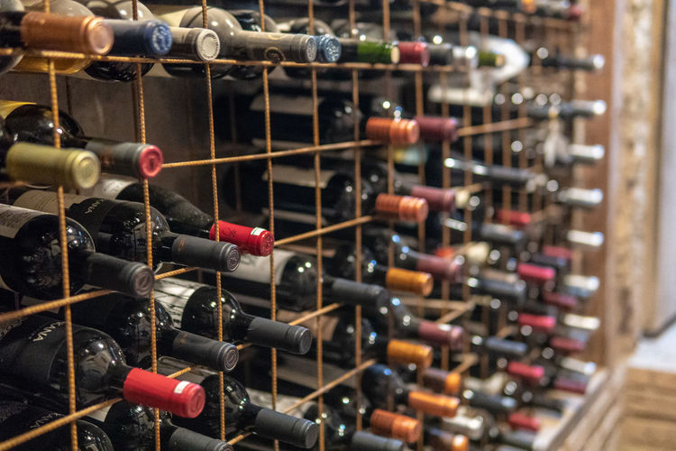 Close-up of wine bottles on rack