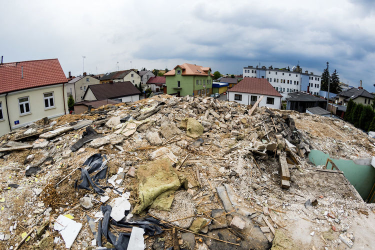 Rubble against houses in city