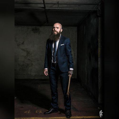 Full length portrait of man standing in corridor
