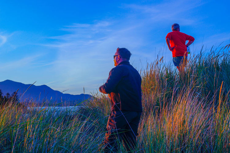 Blue Casual Clothing Field Full Length Grass Landscape Leisure Activity Lifestyles Men Nature Plant Rear View Rural Scene Sky Standing Three Quarter Length Tranquil Scene Tranquility The KIOMI Collection • The Great Outdoors – 2016 EyeEm Awards 43 Golden Moments
