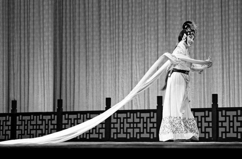Woman In Costume Performing Dance On Stage