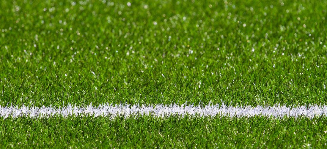 Full frame shot of soccer field with white marking