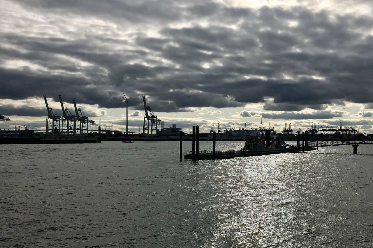 COMMERCIAL DOCK AGAINST CLOUDY SKY