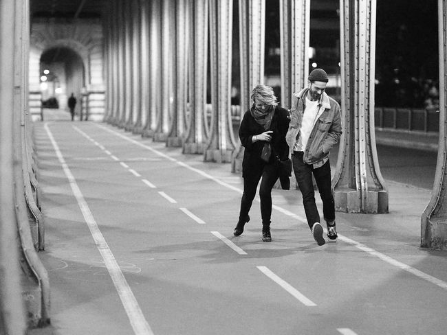 Paris La La Land Black And White Street Photography Paris Street Photography Evening Friendship Full Length Lifestyles Pont De Bir-hakeim Real People Togetherness Walking & Dancing Young Adult