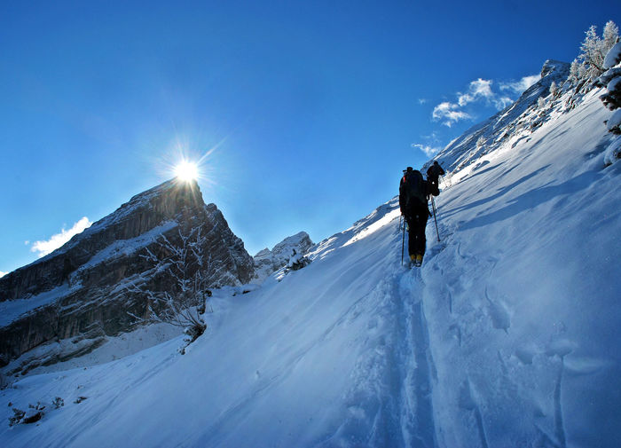 Adventure Backpack Beauty In Nature Cold Temperature Day Full Length Hiking Leisure Activity Lifestyles Low Angle View Mountain Nature Outdoors Real People Scenics Sky Snow Snowcapped Mountain Sunlight Tranquility Walking Watzmann Ramsau  Ramsaubeiberchtesgaden Winter