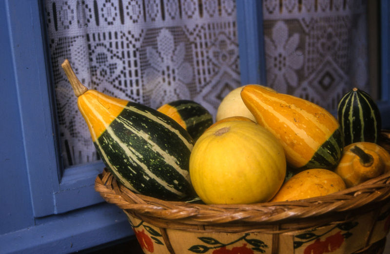 Close-up Of Squash Vegetables In Wicker Basket At Home