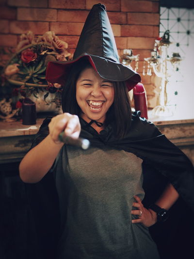 Woman wearing witch costume during halloween