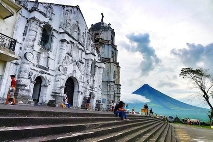 Travel Destinations Cloud - Sky Architecture History People Sky Built Structure Adult One Person Adults Only Day Sea Only Women Outdoors Women Men Building Exterior City Albay, Philippines Albaydaragachurch Mayon Volcano Daraga, Albay Philippines