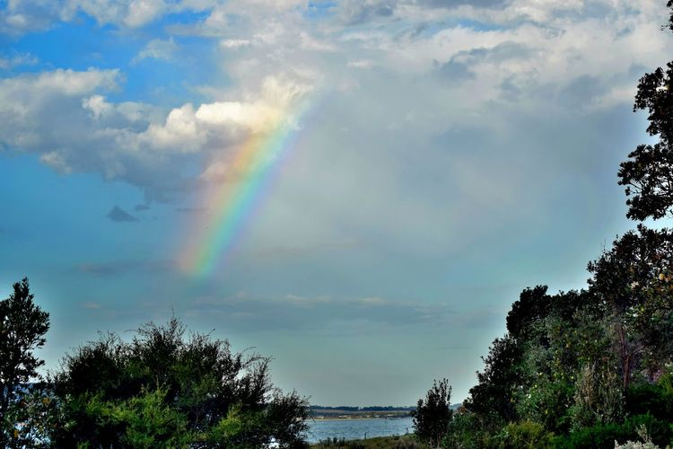 A rainbow over Port Phillip Bay Beauty In Nature Blue Cloud Cloud - Sky Outdoors Rainbow Sky Sunbeam Sunlight Tranquility