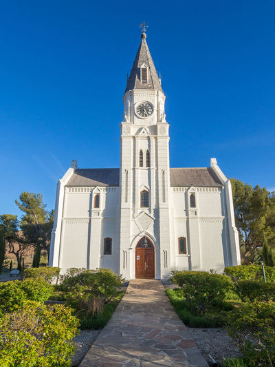 Church Little Karoo South Africa Architecture Bell Tower Blue Building Exterior Built Structure Clear Sky Clock Tower Cross Day History Karoo Nieu-bethesda No People Outdoors Place Of Worship Religion Sky Spirituality Tree