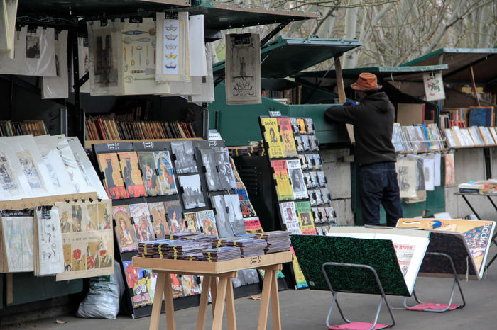 Bouquiniste. Arrangement Book Books Bouquinistes Business Choice Classic Art Clouded Sky Collection Covers For Sale Market Market Stall Music Old Stuff One Person Outdoors Paper River Seine Seine River Banks Typical