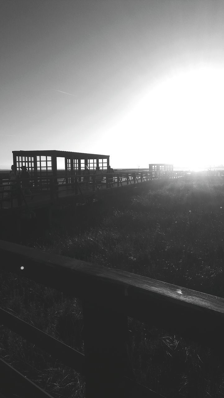 architecture, built structure, sun, bridge - man made structure, no people, clear sky, outdoors, sunset, sky, nature, city, day