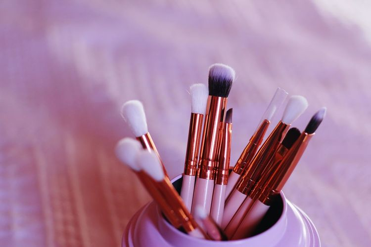 Close-up of make-up brushes in container