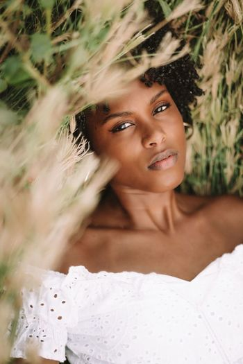 Young black woman relaxing in the grass