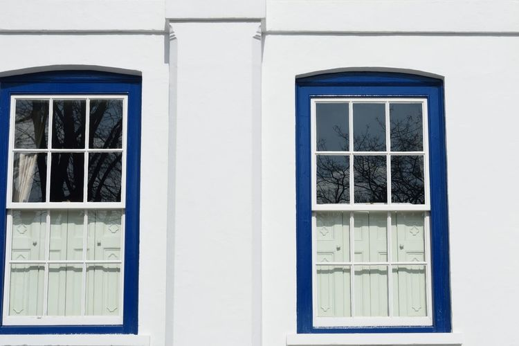 Blue and white windows Window Built Structure Building Exterior Building White Color Blue Windows Architecture