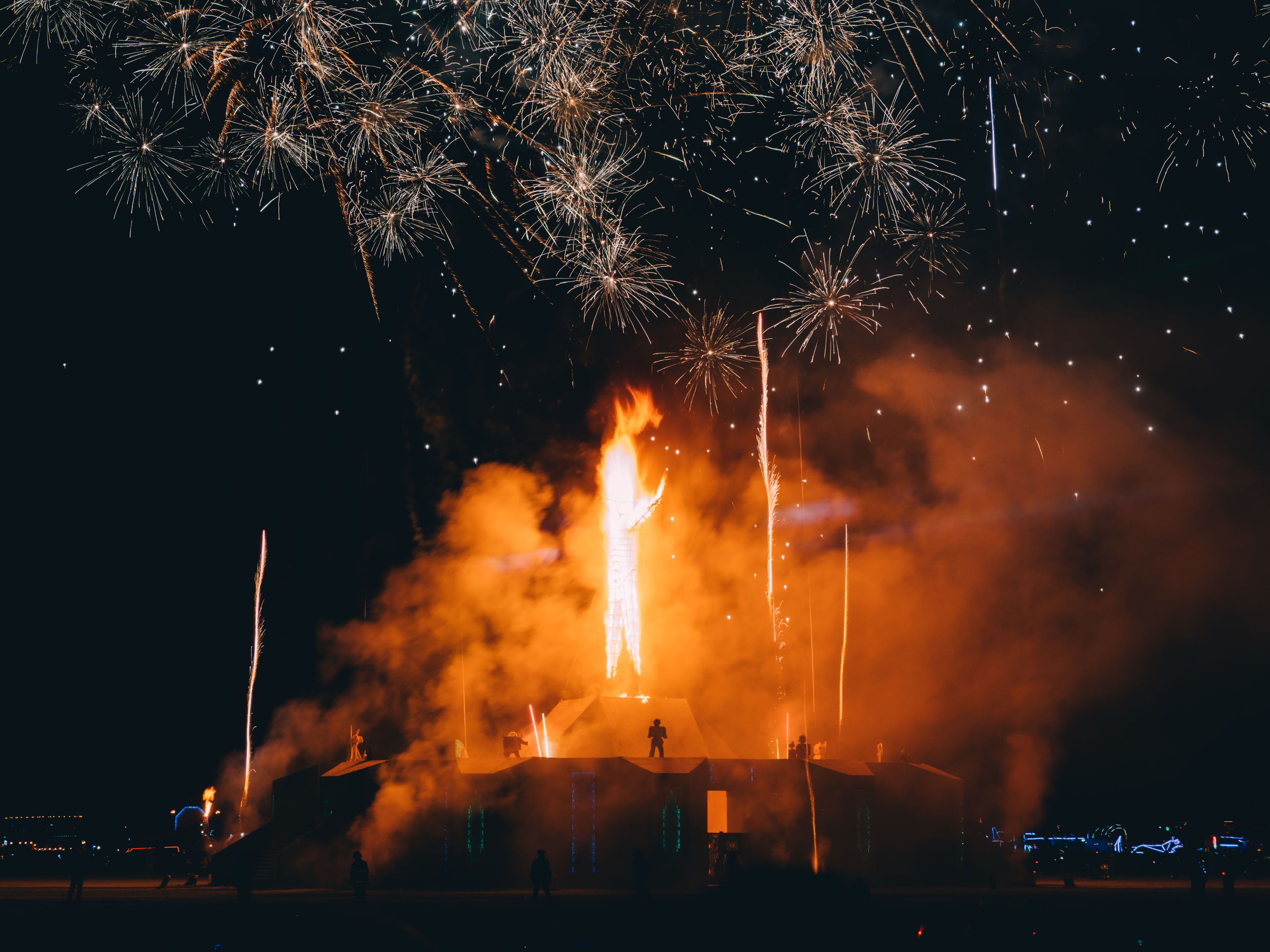 night, burning, fire, illuminated, fire - natural phenomenon, smoke - physical structure, motion, heat - temperature, firework display, firework, flame, architecture, event, nature, building exterior, long exposure, glowing, no people, exploding, built structure, outdoors, firework - man made object, pollution