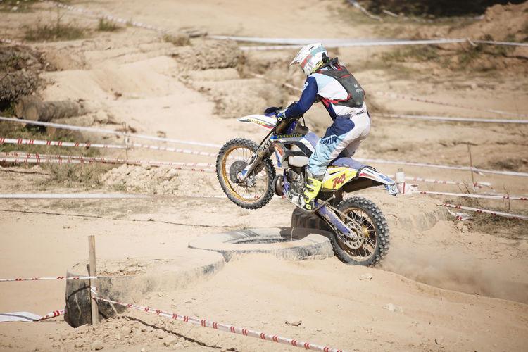 Man riding motorcycle on mud