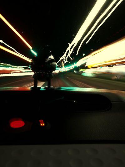 Optimist on the Autobann City Illuminated Crash Road Land Vehicle Motion Long Exposure Speed Driving Light Trail Car Point Of View Vehicle Light Tail Light Multiple Lane Highway Car Interior The Traveler - 2018 EyeEm Awards