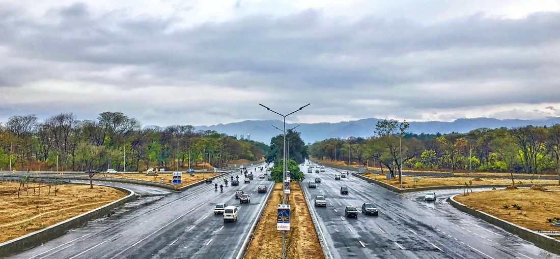 A beautiful view of Islamabad after rain... Amazing Pakistan Beautiful Islamabad Beauty In Nature Cloud - Sky Day Motorway Nature No People Outdoors Road Road Sign Sky Traffic Tree Adapted To The City