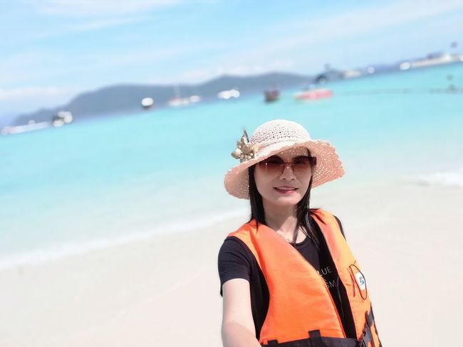 EyeEm Selects Beach Sea Vacations Sand Sun Hat Looking At Camera One Woman Only Summer Nature