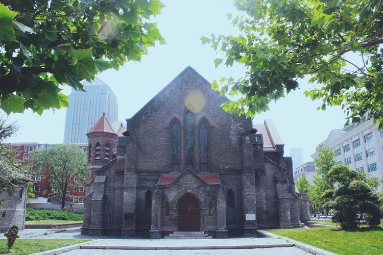 Tianjin China Architecture Blue Building Exterior Built Structure Church Day Exterior Façade Green Color Growth Low Angle View No People Outdoors Place Of Worship Religion Sky Spirituality Travel Destinations Tree