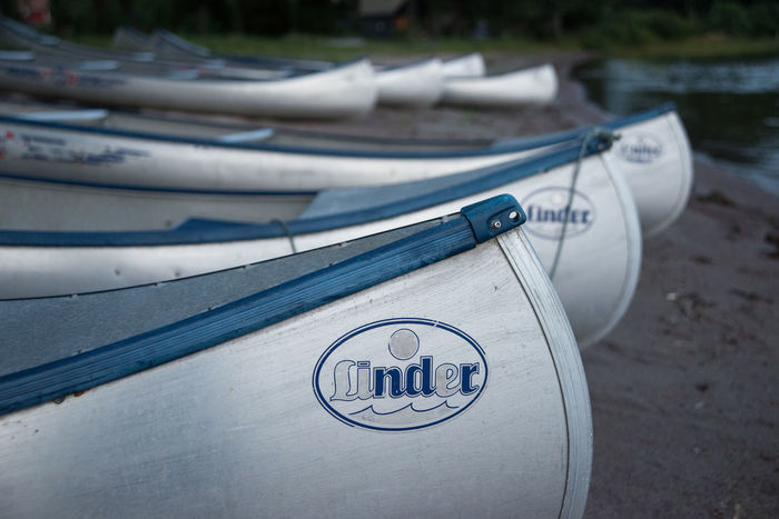 Aland Islands Beach Boats Close Up Harbour In A Row Rowing Boat Selective Focus Side By Side Silver Colored Water Sports