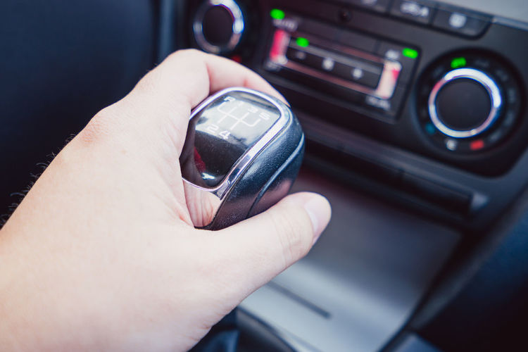 Cropped hand holding gearshift in