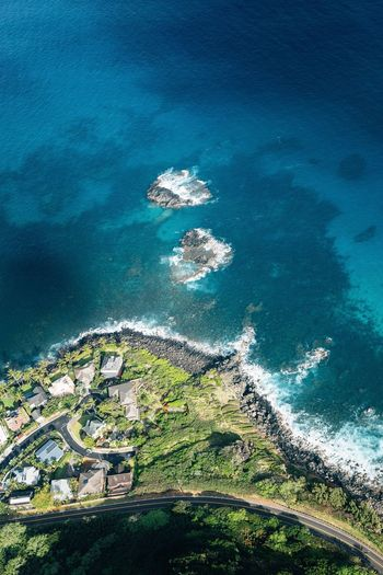 Island from above. Sea Water High Angle View Aerial View Day No People Nature Waterfront Horizon Over Water Blue Scenics Architecture Outdoors Beauty In Nature Built Structure Wave Building Exterior Nautical Vessel