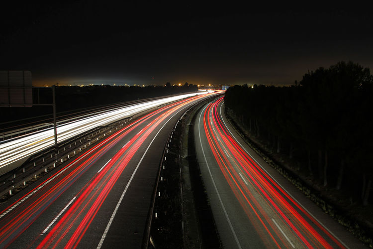 Long exposure shot of highway at night with blurred lights