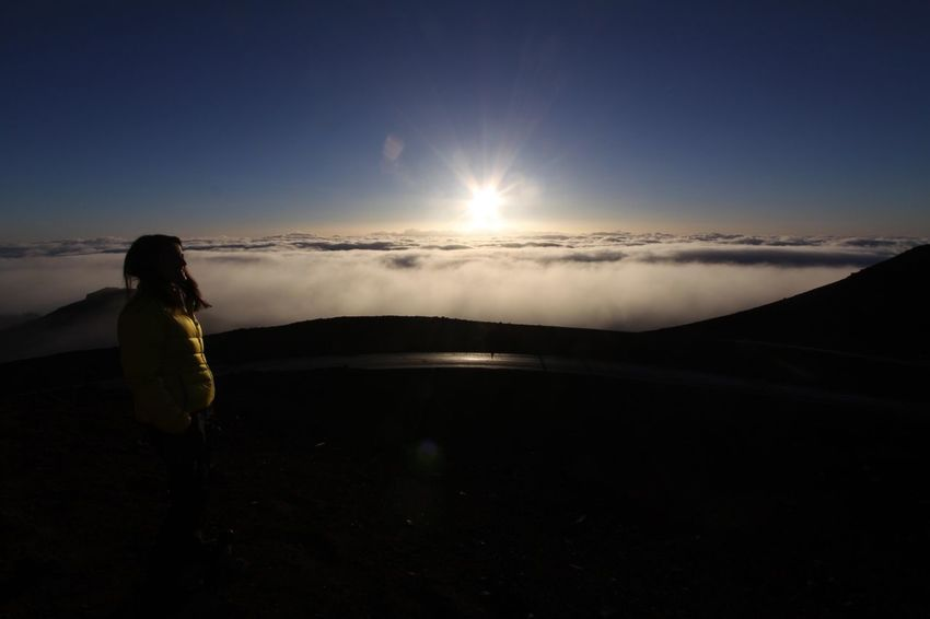 Haleakala, Hawaii Adult Adults Only Beauty In Nature Day Full Length Leisure Activity Lifestyles Mountain Nation Nature One Person One Woman Only Outdoors People Real People Scenics Sky Standing Sunrise Sunset Tranquility Women Young Adult
