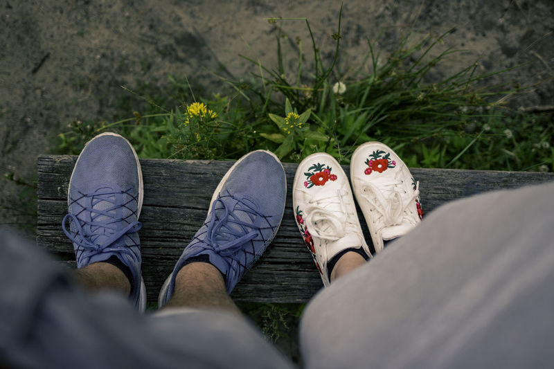Casual Composition Flower Shoes Framing Goals Low Angle View POV Relationship Walking Around Blue Sneakers Boy & Girl Casual Clothing Grass Jeans Lifestyles Outdoors Personal Perspective Relaxation Shoes Shorts Sneakers Standing White Shoes Young Adult First Eyeem Photo