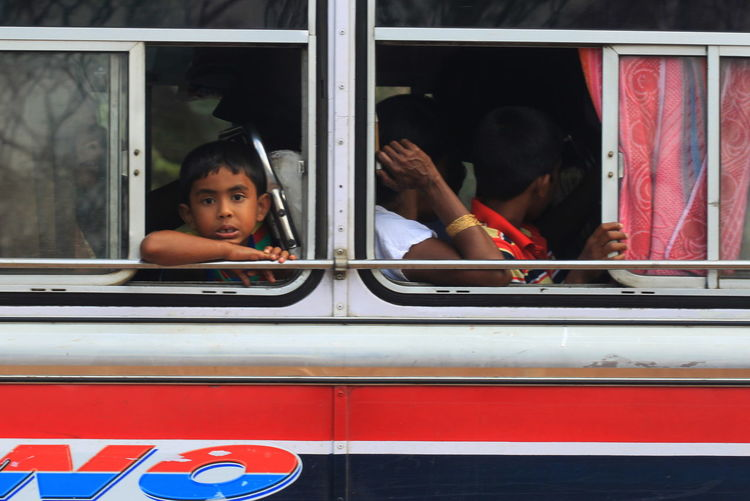 Bus Day Lifestyles Little Boy Looking At Camera Mode Of Transport Plonnaruwa Sitting Sri Lanka Window